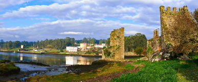 Towers of the west. Catoira, Pontevedra, Spain. Ruins of two defensive towers at the mouth of Ulla river Royalty Free Stock Photos