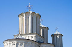 Towers of white orthodox church in Bucharest, Romania Stock Image
