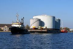 Towing. A large  fuel tanks in the port of Gdansk by tugs Stock Photos