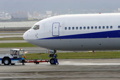 Towing Aircraft. At Kansai Airport, Japan Royalty Free Stock Images