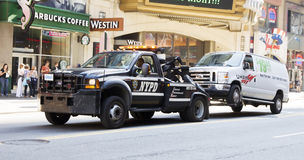 Towing a car. NYPD vehicle towing a van on 42nd street in NY royalty free stock image