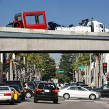 Towing the car. Heavy duty truck towing the car on California freeway royalty free stock photos