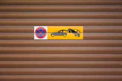 Towing car. Evacuation sign. No parking on wooden background. Royalty Free Stock Image