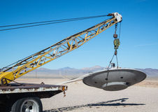 Towing a flying saucer. Disabled flying saucer on a tow truck, Area 51, Rachel, Nevada Royalty Free Stock Photos