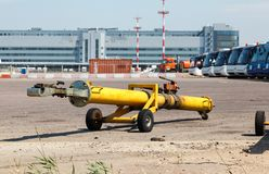 The towing hitch carrier for aircraft. And truck on the ramp at the airport stock photos