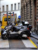 Towing motorcycles. Motorcycles being towed because of parking violations in Florence, Italy Stock Image