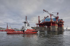 Towing Oil Rig in the Port of Gdansk, Poland. Stock Images