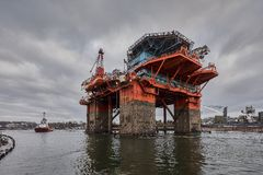 Towing Oil Rig in the Port of Gdansk, Poland. Royalty Free Stock Photo