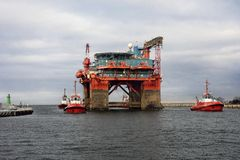 Towing Oil Rig in the Port of Gdansk, Poland Royalty Free Stock Image