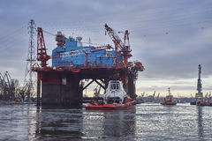 Towing Oil Rig in the Port of Gdansk, Poland. Royalty Free Stock Photography