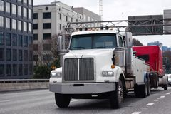 Towing powerful semi truck tow broken big rig semi truck fleet o. Powerful towing big rig semi truck tow broken and damaged big rig semi truck red fleet in the royalty free stock images