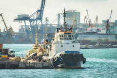 Towing ship berthed at the port Stock Photography