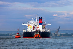 Towing the tanker Royalty Free Stock Photo
