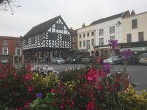 The town above the flowers. Ledbury 2017 in the Cotswolds Royalty Free Stock Photo