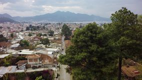 Town aerial view. Aerial view of de las Casa San Cristobal in Mexico, fly above town in mountain stock footage
