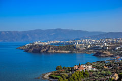 Town of Agios Nikolaos and the Mirabello Bay. Crete. Panoramic high point view of the picturesque town of Agios Nikolaos and the Mirabello Bay. Crete, Greece Royalty Free Stock Images
