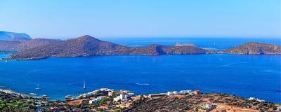 Town of Agios Nikolaos and the Mirabello Bay. Crete. Panoramic high point view of the picturesque town of Agios Nikolaos and the Mirabello Bay. Crete, Greece Stock Photo