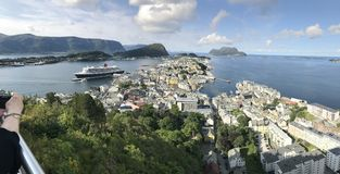 Town of Alesund, Norway, with Queen Mary 2 visiting Royalty Free Stock Image