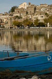 Town of Anguillara in Italy. Overlooking placid lake Stock Image