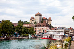 The town of Annecy daytime, busy with people, walking, boat sail Stock Image