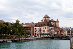 The town of Annecy daytime, busy with people, walking, boat sail Royalty Free Stock Photo