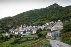 Town in the Aragonese Pyrenees, Spain. Overview of a mountain in the Aragonese village entrance on the road to the right of the image Stock Photo
