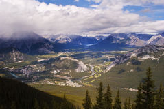 Town of Banff. Bird's eye view of Banff with Bow river, Tunnel Mountain and surrounding Canadian Rockies Royalty Free Stock Images