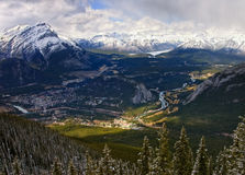 Town of Banff, Alberta. Bird's eye view of Banff with Bow river, Tunnel Mountain and surrounding Canadian Rockies. On the left is 2998m high peak of Cascade Royalty Free Stock Photos