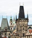 Town bridge tower and Saint Nicholas church in Prague Royalty Free Stock Images