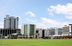 Town in bright healthy environment, Brunei. Image of a town in a bright healthy environment, Brunei. The green grass in the foreground is an open big space which Royalty Free Stock Image