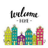 Town building. City streets with phrase welcome home. Stock Photography