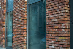 Town building, front door of red brick house with staircase. Royalty Free Stock Images