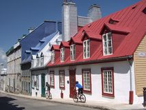 Town buildings. A row of  town buildings in Quebec and people riding bicycles Royalty Free Stock Photo