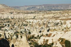 Town in Cappadocia, cliffs around it Royalty Free Stock Image