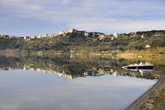 Castel Gandolfo lake. The town of Castel Gandolfo, the summer residence of the popes, reflecting on its lake Royalty Free Stock Image