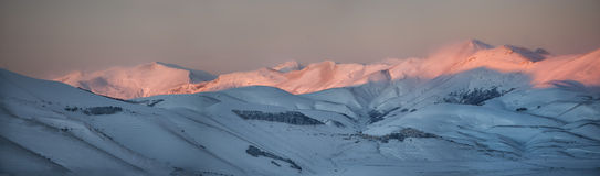 The town of Castelluccio di Norcia at sunset, winter with snow, Stock Image