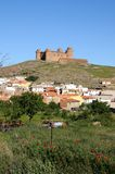Town and castle, La Calahorra, Spain. View of the castle, built 1509 - 1512, (Castillo de La Calahorra) and town with poppies in the foreground, Lacalahorra Stock Images