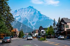 Town Center of Banff, Canada. Banff, Canada--August 2, 2018. The main street in Banff with the mountains looming in the background Royalty Free Stock Photos