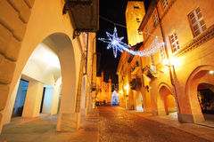 Town center at evening. Alba, Italy. Alba old town central street with illuminations and Christmas Tree against San Lorenzo Cathedral on the background in Italy Stock Photo