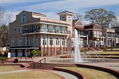 Town Center with Fountain. Building that is part of a mixed use community, with fountain in foreground Royalty Free Stock Photography