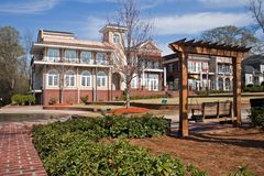 Town Center with Park. Building that is part of a mixed use community, with swing in foreground Royalty Free Stock Photos