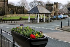 Town Centre of Standish in Wigan. The view over the flowers towards the town centre of Standish Stock Photos