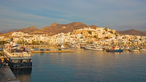 The town Chora (Hora) on the Naxos island at evening light in the Aegean Sea. Stock Photos