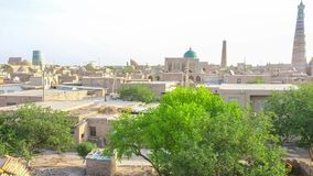 The town in citadel. The old town with numerous mosques, minarets, medresses and museums located inside of the citadel with well preserved ramparts, Khiva stock video footage