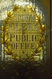 Town clerk office stained glass window in Glasgow City Chambers. Town clerk office stained glass window in the municipal offices on george square glasgow. yellow stock photo