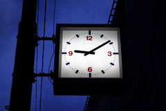 Town clock. In the evening hours Royalty Free Stock Photo