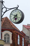 The town clock on the background of tiled roofs of Tallinn Stock Images