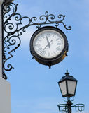 The town clock and street lamp Royalty Free Stock Photography