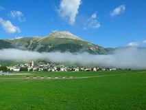 A town in clouds. The Swiss mountain small town in clouds Royalty Free Stock Image