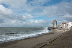 Town on the coast. Deserted city beach in winter Stock Photos